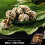 6 Schokokugeln, die mit Kokos bestreut sind, auf zwei großen grünen Blättern gestapelt; unten Werbung für Heldenmahl, das offizielle Dungeons & Dragons Kochbuch